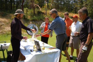 Pouring cider at the spectacular 17th hole at Olympic View Golf Course